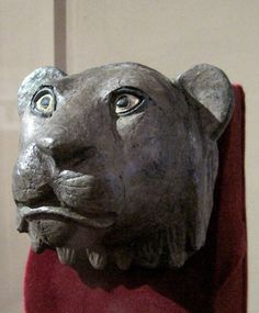 Lion's head finial from an arm of a chair made with silver, shell and lapis lazuli from the Sumerian city of Ur, 2550-2450 BCE. Univ. of Penn. Museum of Archaeology and Anthropology, Philadelphia.
