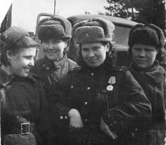 Soviet female soldiers strike a pose for the camera. The lady with her hands on the waist is a lieutenant carrying a decoration for bravery. All-female Red Army and Air Force units fought very much like their male counterparts and received their handsome share of battle citations and individual decorations.