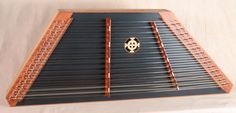 2012 - #1593 - A James Jones 15/14 Custom Hammered Dulcimer with a Mahogany frame, Redwood SB made black, Bubinga pin panels, with Paduak  bridges and Lacewood trim.