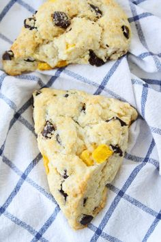 Mango Dark Chocolate Chunk Scones Recipe on twopeasandtheirpod.com Soft, tender, buttery scones with juicy mango pieces and dark chocolate chunks! These scones are amazing! You will love the mango and dark chocolate combo!