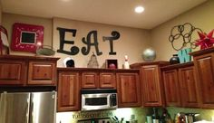 Above cabinet decorating. Like the EAT.
