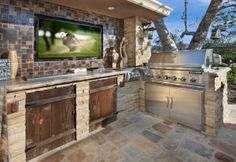 "Get terrific suggestions on ""outdoor kitchen designs layout patio"". They are rea… Get terrific suggestions on ""outdoor kitchen designs layout patio"". They are readily available for you on our website. Outdoor Kitchen Countertops, Backyard Kitchen, Outdoor Kitchen Design, Granite Kitchen, Kitchen Tv, Corian Countertops, Stone Kitchen, Kitchen Appliances, Back Patio Kitchen Ideas"