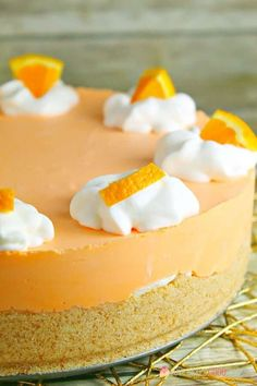 This No-Bake Orange Creamsicle Cheesecake is a nostalgic bite of bright orange and creamy vanilla, reminiscent of those long-gone summer days of your childhood. No-Bake Orange Creamsicle Cheesecake --- PIN THIS RECIPE --- As much Orange Cheesecake Recipes, No Bake Pumpkin Cheesecake, Orange Creamsicle Cheesecake Recipe, Banana Cheesecake, Summer Desserts, No Bake Desserts, Dessert Recipes, Jello Desserts, Cheesecake Desserts