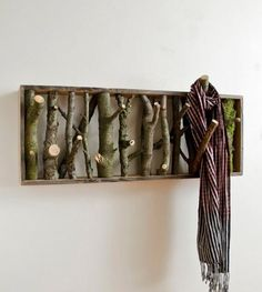 Tree branch hangers - LOVE!!!  Make much larger in the hallway to serve as a graphic piece of artwork that can dual function for guest coats!