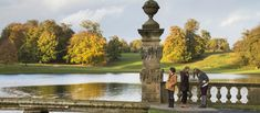 three ladies admire an autumnal studley lake. England Tourism, Water Garden, Autumnal, Golf Courses