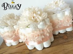 VINTAGE PEACH PINK SATIN, with LIGHT IVORY PEONY TOPPERS . . . You will receive a set of 3 mini diaper cakes. Please send me a message if you would like to change anything on this item, for example, ribbon color, floral topper, or any other décor to best fit the theme of your event! Check out matching 3 tier in my shop!  . . . At checkout, I will ask for your shower date so that all of my orders are managed appropriately and timely. If you select a date that is LESS THAN 10 DAYS at the time…