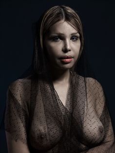This striking series of portraits features partially robed models undergone significant plastic surgery. Facial modification, implants, lifts, collagen injections and their multiple combinations. These photos may seem extreme to many, but there's something transcendent in their classical poses lit in gorgeous chiaroscuro, their determined faces.
