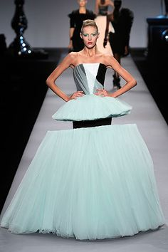 "Spring Summer 2010. Viktor & Rolf explain ""With the credit crunch and everybody cutting back, we decided to cut tulle ball gowns""."