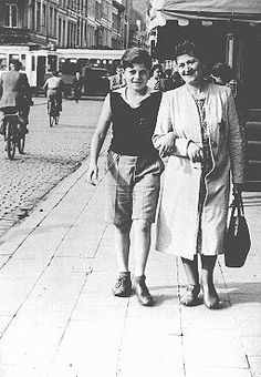 Shoshane Varmel Levy and her son, Jules, wearing the compulsory yellow badge, on a street in Antwerp. Belgium, June 1942.