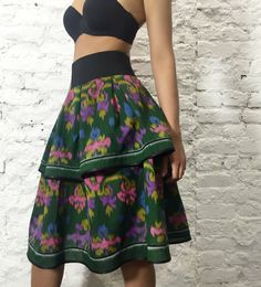 """Designer double-layered Green Queen skirt of Indonesian cotton """" ikat """". Ikat - a fabric made ancient method of hand weaving. Named technique about 5 000 years, its history goes back to the Bronze Age. Skirt decorated with tassels handmade lace and satin black on the bottom. Performed in a single copy. Exclusive Boho-chic!"""