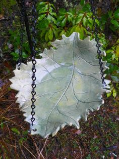 leaf birdbath put in holes when making the leaf , to be able to hang it from tree branch