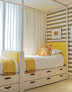 built in beds for kids-love everything about this. Striped wall, sunny yellow, dark hardware, curtains across the whole wall to make the window seem much bigger. Love.