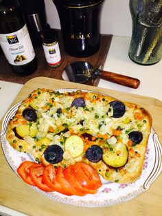 Homemade Organic stuffed vegetarian mozzarella cheese pizza: Topped w/ purple, Yukon, red, and Japanese yam potatoes, sprinkled w/ fresh Basa Fish, organic peas/ carrots Served w/ a side of steak tomatoes seasoned/basted w/365 olive oil & basil...
