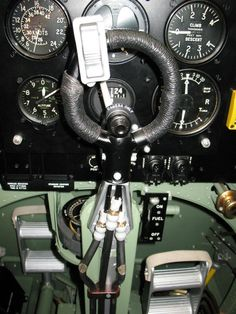 Mk V version of gun button at the top of control column was a multi-position air valve. Upper part fires cannon, lower part Brownings, raised middle all armament simultaneously. The three pneumatic lines run down the control column. This particular Spitfire has also a camera-only operating button