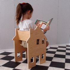When sitting-down-time is over, this clever children's chair can be used as a dollhouse.