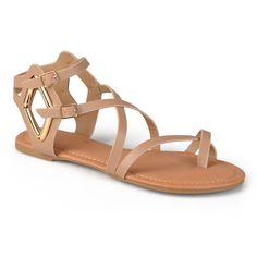Make a statement in chic gladiator flats by Journee Collection. These stylish flat sandals feature premium faux leather uppers that border the big toe and highlight a crisscross strappy design. Shiny metal diamond-shaped rings accents the look.
