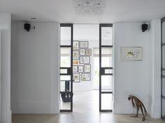 Piet Boon Styling by Karin Meyn | Black and white interior with colourful art
