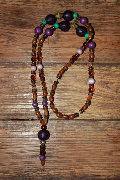 Necklace with brown, lila, purple & green-turquoise wood beads, coconut shell rondelles, brown glass beads & Mirage Moon Changing Mood beads. 25 €  (27)