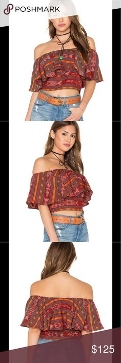Stela 9 Sunset Flounce Top Many of the items created by Stela 9 are one of a kind and handmade by skilled artisans. This is a gorgeous top with vibrant colors! 100% cotton Dry clean only Elasticized neckline Stela 9 Tops Crop Tops