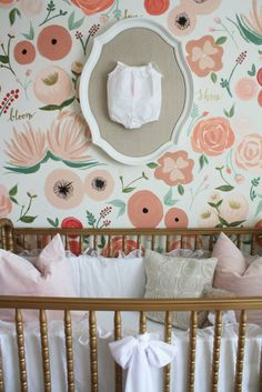 Cute, simple idea for wall decor above the crib: framed, monogram onesie!