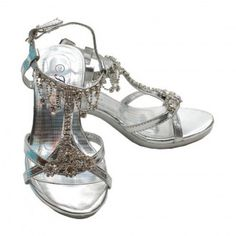 """A glamorous shoe your little girl will love! This silver kitten heel shoe from Fabulous is loaded with sparkling rhinestones from the toe to the ankle. The chandelier rhinestone design at the ankle is a favorite. The cute rhinestone heel is 1"""" and rhinest"""