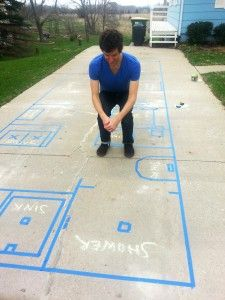 Feelin' it out - Life-size tape floorplan:  That's me, taking a pretend dump in the composting toilet
