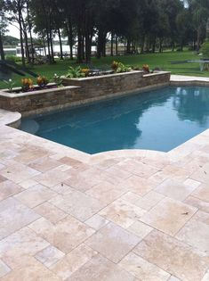 beautiful and modern pool with built in hot tub using travertine