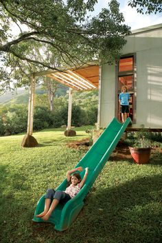 Great little house set up in Hawaii.  Slide out of the kids room to the outside.