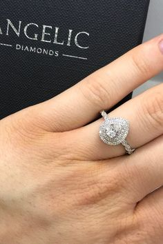 Could this be your dream engagement ring? It features a beautiful pear-shaped diamond, surrounded by a halo of smaller diamonds with even more diamonds running down the band. Pear Diamond Engagement Ring, Elegant Engagement Rings, Wedding Rings, Pear Shaped Diamond, Halo Diamond, Beautiful Diamond Rings, Eternity Ring, White Gold Rings, Round Diamonds