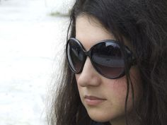 Very interesting portrait photograph of a girl wearing sunglasses