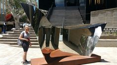 """Sculpture entitled """"Voyage """" mirror polished stainless. steel. ...sculpture at Circa Johannesburg. ."""