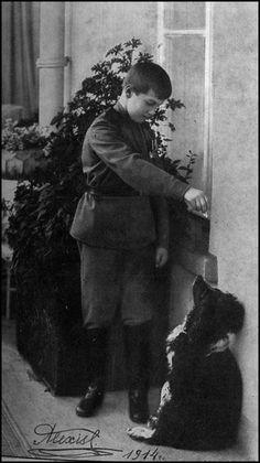 Alexei Romanov and his spaniel Joy
