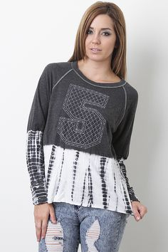 Take control of your casual look with the Moody Number Top. Featuring a round neckline, soft stretch fabrication, full length sleeves, tie dye print detail, stitching accents, and a high low hem.