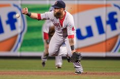 Mike Napoli First baseman Mike Napoli #12 of the Boston Red Sox bobbles a ball hit by Chris Davis #19 of the Baltimore Orioles during the ni...