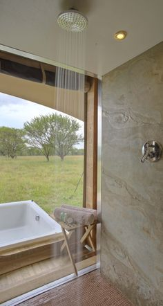 your open sided shower and sunken hot tub on your private deck at Roving Bushtops. Luxury in the Serengeti at its height
