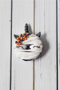 Halloween Unicorn Donuts are a fun and creative way to celebrate Halloween. Baked donuts frosted with candy melts and decorated in a haloween theme. |#halloweenunicorndonuts #halloweenunicron #halloweendonuts #halloween #halloweendesserts #halloweentutorial #tutorial #candymelts #decorateddonuts #bakeddonuts #unicorndonuts #unicron #unicrondesserts  onesarcasticbaker.com|
