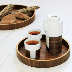 Finnsih design  REUNA wooden serving trays by Tonfisk Design. Come in two sizes and walnut and oak finish. Excellent as bread basket, carryitng teapots and teacups or a serving plate. Designed by Irish Finnish designer Brian Keaney