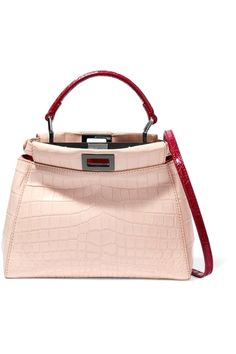 Fendi's cult 'Peekaboo' bag is updated in a feminine blush hue for Fall '16. Crafted from smooth crocodile, this structured style is detailed with contrasting red top handle and an optional shoulder strap. The signature turn-lock fastenings open to two supple, leather-lined compartments with room for your everyday essentials - think wallet, cell phone and keys. leather handbags diy