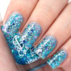 Blue sparkly nail art