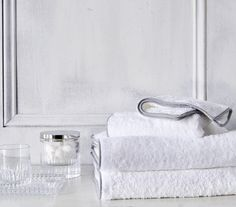 Gray and white bathroom accessories, bath towels, crystal container, tray and tumbler from our Pierre collection. Must haves for any bathroom design. Bath Linens, Bath Rugs, Bath Towels, Gray And White Bathroom, White Bathroom Accessories, Waterworks Bathroom, Bathroom Cabinetry, Contemporary Bathroom Designs, Linen Shop