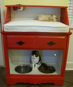 Pet Station Created From Vintage Secretary Desk. Mom has a dry bar/wash stand that I would love to get my hands on to do this with though her's has a double door at the bottom and I would leave the doors and take the shelves out so I could put the litter box in there and cut a hole in the side for the door. Then put food and water on top and it would be kid proof and cat-tastic.