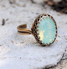 Swarovski Crystal Ring - Oval Crown Victorian - Sea Foam Pacific Opal and Antiqued Brass Adjustable Ring. $28.00, via Etsy.