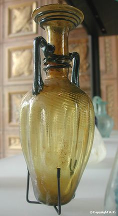 Amphoriskos - Fourth century AD, Near East (?), Blown molded glass, the handle and decorative elements added at a later stage