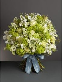 This bouquet is a gorgeous mix of seasonal favourites such as white roses, ranunculus, guelder and lilac.  http://wildatheart.com/mother-s-day/florist-s-favourite.html