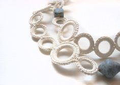 White necklace silk-linen crochet with light blue ceramic beads. Handmade textile jewelry by Aliquid. €56,00, via Etsy.