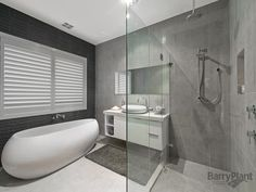 Photo of a modern bathroom design with freestanding bath using frameless glass from the bathroom galleries - Bathroom photo Browse hundreds of images of modern bathrooms & photos of freestanding bath in bathroom designs. Old Bathrooms, Yellow Bathrooms, Steam Showers Bathroom, Glass Bathroom, Bathroom Renos, Bathroom Renovations, Modern Bathrooms, Bathroom Gallery, Bathroom Photos