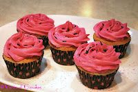 Fuchsia Frosted Cupcakes with Black Jimmies Sprinkles
