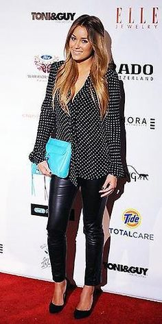 LC, does it right with a simple black & white outfit and a pop of color with her RM MAC
