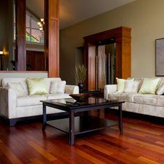 love hard wood floors, sleek lines, contrasting colors      http://www.goodhousekeeping.com/home/home-decor-gallery/decor-ideas-living-room