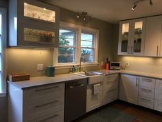 Here's a bright, practical IKEA kitchen in Upstate New York. Our customer wanted. Here's a bright, practical IKEA kitchen in Upstate New York. Our customer wanted glass doors with lots of lighting. We like the simplicity of this kit. Menards Kitchen Cabinets, Cabinets To Ceiling, Modern Kitchen Cabinets, Modern Kitchen Design, Kitchen Furniture, Kitchen Ideas, Ikea Cabinets, Upper Cabinets, Modern Ikea Kitchens